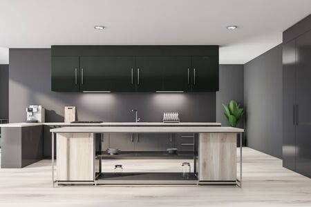 Interior of modern kitchen with gray walls, wooden floor, gray countertops with built in sink and cooker, green cupboards and wooden island for cooking. 3d rendering