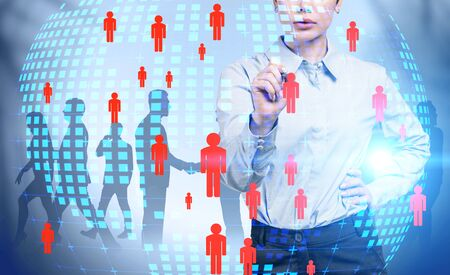 Confident young businesswoman working with futuristic social network interface with planet hologram and business people in background. Concept of HR and global world. Toned image double exposure