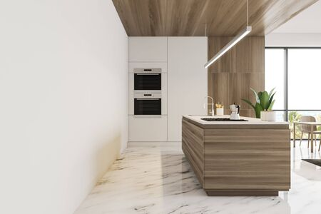 Interior of stylish kitchen with white and wooden walls, marble floor, wooden island with built in sink and cooker and two ovens. 3d rendering Banco de Imagens