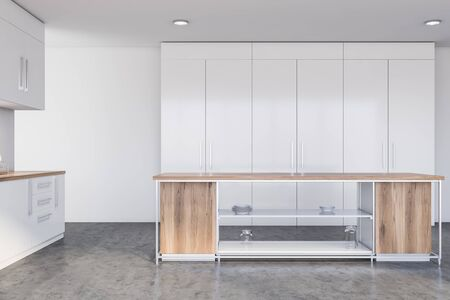 Interior of modern kitchen with white walls, concrete floor, white countertops and cupboards and wooden island for cooking. 3d rendering