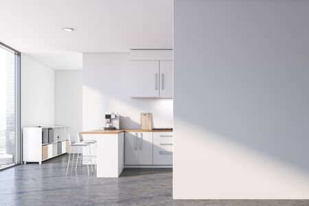 Interior of modern kitchen with white walls, concrete floor, white countertops and cupboards, bar with stools and cabinet in the background. Blank mock up wall to the right. 3d rendering Banco de Imagens