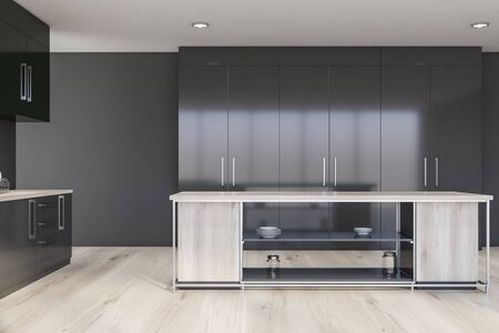 Interior of modern kitchen with gray walls, wooden floor, gray countertops, green cupboards and wooden island for cooking. 3d rendering