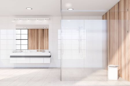 Interior of spacious modern bathroom with white and wooden walls, tiled floor, double sink with big mirror above it and walk in shower with glass walls. 3d rendering