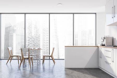 Interior of panoramic kitchen with white walls, concrete floor, white countertops and cupboards, stylish round dining table with chairs and window with cityscape. 3d rendering Banco de Imagens