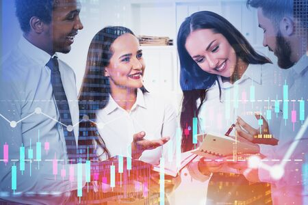 Members of happy diverse business team working together in office with double exposure of forex chart and cityscape. Concept of teamwork and stock market. Toned image Standard-Bild