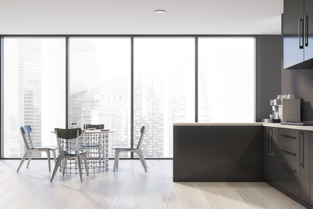 Interior of panoramic kitchen with gray walls, wooden floor, gray countertops, green cupboards, stylish round dining table with chairs and window with cityscape. 3d rendering