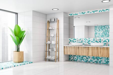 Corner of stylish bathroom with white tile and blue mosaic walls, double sink on wooden countertop with large mirror above it and rack with towels and creams. 3d rendering