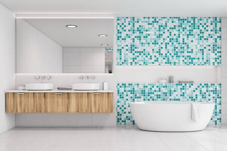 Interior of spacious bathroom with white tile and blue mosaic walls, comfortable bathtub and double sink standing on wooden countertop. 3d rendering