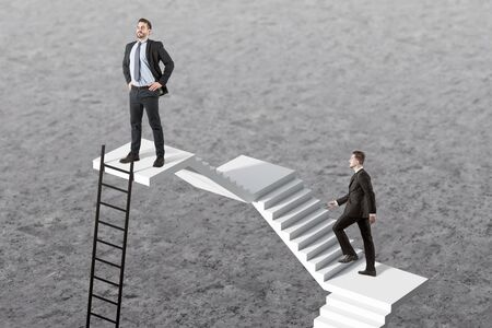 Confident young businessman standing on top of staircase with his colleague following him. Concept of career ladder and competition. Shortcut to success Stock fotó