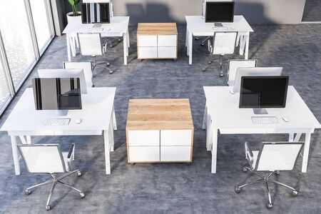 Top view of modern office or computer lab with gray walls, panoramic windows, concrete floor and compact white tables with desktops on them. 3d rendering