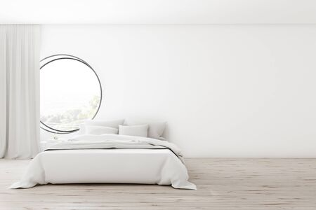 Comfortable minimalistic white bedroom with white walls, wooden floor, master bed with white blanket and round window. 3d rendering mock up Stok Fotoğraf