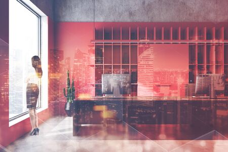 Young businesswoman standing in luxury loft office with red and concrete walls, long computer table and double exposure of cityscape. Concept of corporate life. Toned image