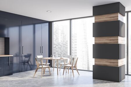 Interior of panoramic kitchen with gray and white brick walls, concrete floor, dark blue countertops and cupboards, round dining table with chairs and column. 3d rendering