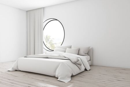 Comfortable minimalistic white bedroom corner with white walls, wooden floor, master bed with white blanket and round window with curtain. 3d rendering mock up