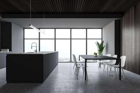 Interior of modern kitchen with grey and wooden walls, concrete floor, large window with mountain view, gray dining table with chairs and island with built in sink. 3d rendering