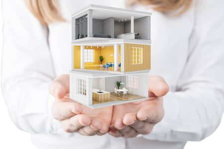 Young woman architect holding project of modern house with different rooms. Concept of design and development. Real estate