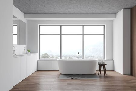 Interior of stylish bathroom with white walls, wooden floor, window with white bathtub under it and comfortable double sink with large mirror. 3d rendering Banque d'images - 131317626