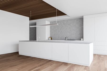 Corner of stylish kitchen with white and concrete walls, wooden floor, white island with built in sink and countertops with cooker. 3d rendering Фото со стока