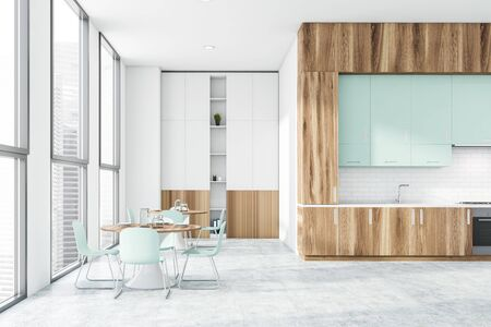 Interior of stylish kitchen with white and brick walls, concrete floor, wooden countertops, white bookcase and two round dining tables. 3d rendering