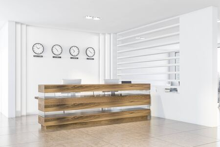 Corner of modern office with white walls, tiled floor, wooden reception table with computers and clocks showing time in New York, Sydney, London and Tokyo. 3d rendering
