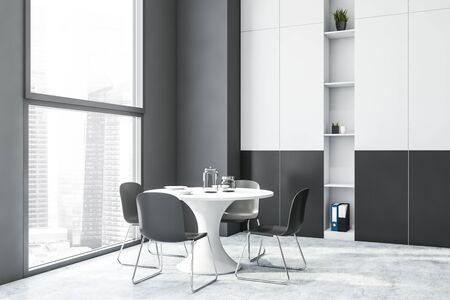 Interior of modern dining room with gray walls, concrete floor, windows with cityscape, round table and white and gray bookcase. 3d rendering Stok Fotoğraf