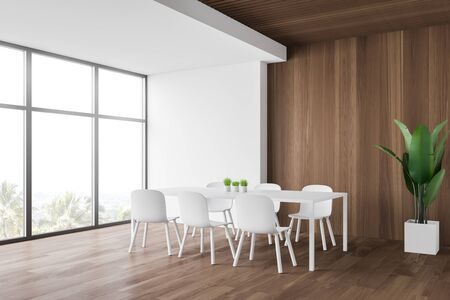 Interior of minimalistic dining room with white and wooden walls, wooden floor, comfortable long white dining table with chairs and potted plant. 3d rendering