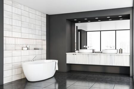 Corner of original bathroom with gray and wooden tiled walls, tiled floor, panoramic window with cityscape, comfortable bathtub and double sink with large mirror. 3d rendering