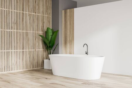Corner of minimalistic bathroom with white and wooden walls, wooden floor, comfortable white bathtub and potted plant. Concept of relaxation. 3d rendering