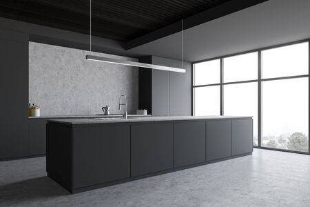 Corner of stylish kitchen with grey and concrete walls, concrete floor, large window with mountain view, gray island with built in sink and countertops with cooker. 3d rendering