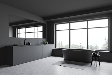 Corner of stylish bathroom with grey walls, concrete floor, window with gray bathtub under it and comfortable double sink with large mirror. 3d rendering