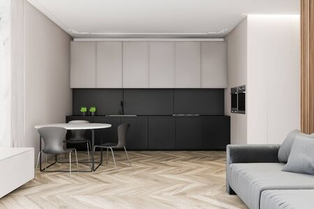 Interior of modern kitchen with white and gray walls, gray countertops, white cupboards, round dining table with chairs and comfortable grey sofa. 3d rendering