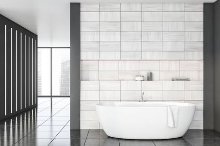 Interior of stylish bathroom with gray and wooden tile walls, tiled floor, panoramic window and comfortable white bathtub with shelf above it. 3d rendering