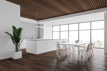 Corner of modern kitchen with white and wooden walls, wooden floor, large window with tropical view, white dining table with chairs, island with built in sink and white countertops. 3d rendering