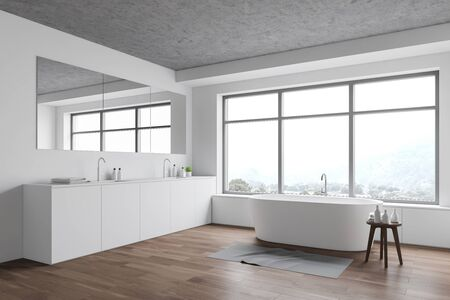 Corner of stylish bathroom with white walls, wooden floor, window with white bathtub under it and comfortable double sink with large mirror. 3d rendering
