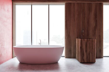 Interior of modern bathroom with red and wooden walls, concrete floor, white bathtub near large window and wooden sink. 3d rendering Фото со стока