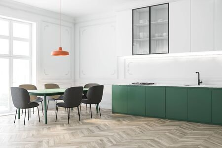 Corner of luxury kitchen with white walls, wooden floor, white cupboards, green countertops and massive marble dining table with gray chairs. 3d rendering Stock Photo
