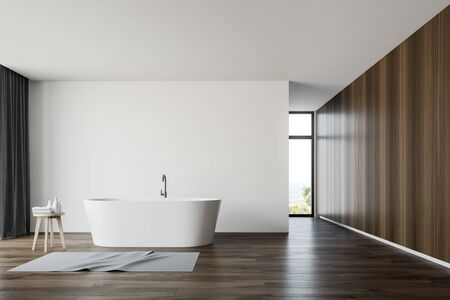 Interior of spacious bathroom with white and wooden walls, wooden floor, comfortable white bathtub with carpet near it and narrow window. 3d rendering