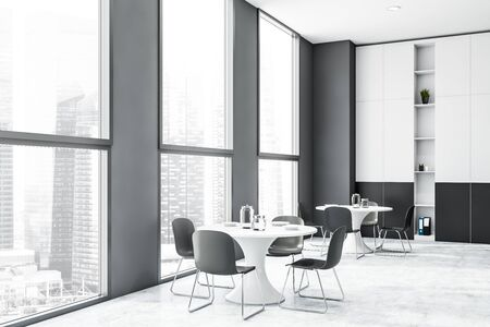 Interior of modern office canteen with gray walls, concrete floor, windows with cityscape, round dining tables and white and gray bookcase. 3d rendering