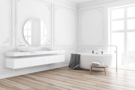 Corner of classic style bathroom with white walls, wooden floor, comfortable bathtub with gray towel on it and double sink with round mirror. 3d rendering