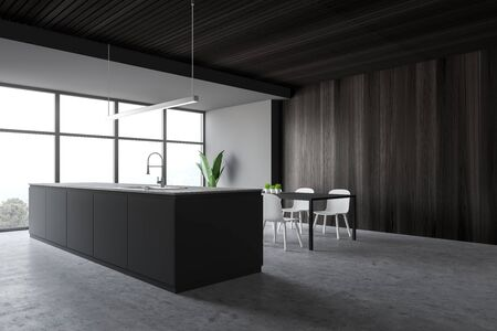 Corner of stylish kitchen with gray and dark wooden walls, concrete floor, large window with mountain view, grey island with built in sink and dining table with chairs. 3d rendering