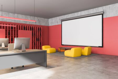 Interior of modern loft open space office with red walls, rows of computer desks, bookcases with folders and lounge area with yellow armchairs and mock up projection screen. 3d rendering