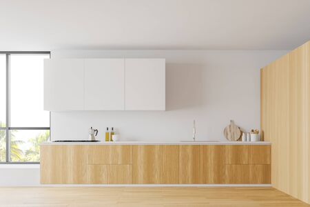 Comfortable modern kitchen interior with white and wooden walls, wooden floor, white cupboards and wooden countertops with built in sink and stove. 3d rendering