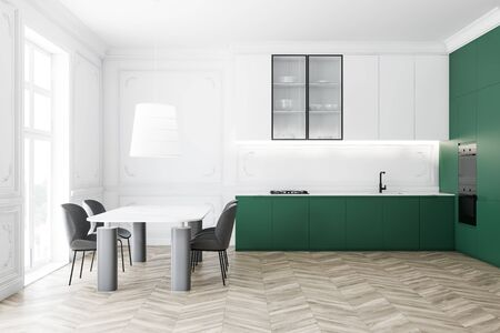 Interior of luxury kitchen with white walls, wooden floor, white cupboards, green countertops and massive marble dining table with gray chairs. 3d rendering Stock Photo
