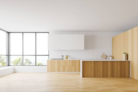 Interior of spacious kitchen with white and wooden walls, wooden floor, large windows, wooden countertops, white cupboards and island. 3d rendering