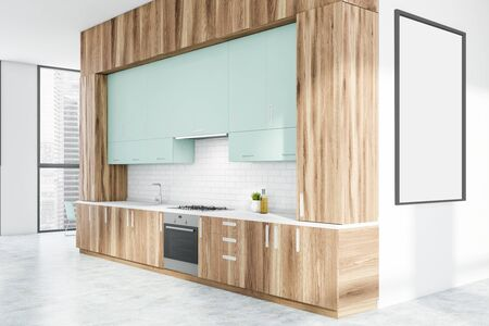 Interior of stylish kitchen with white and brick walls, light blue cupboards, wooden countertops with built in stove and sink and vertical mock up poster frame. 3d rendering