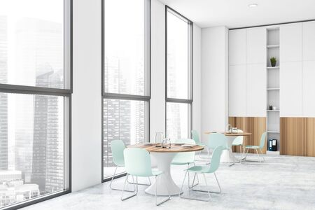 Interior of modern office canteen with white walls, concrete floor, windows with cityscape, round dining tables and white and wooden bookcase. 3d rendering Stok Fotoğraf