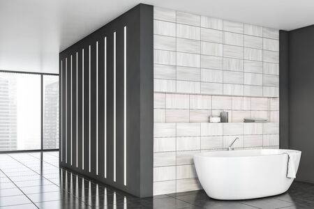 Corner of stylish bathroom with gray and wooden tile walls, tiled floor, panoramic window and comfortable white bathtub with shelf above it. 3d rendering Reklamní fotografie