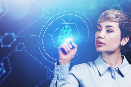 Beautiful young woman working with futuristic cyber security HUD interface. Concept of computer science and data protection. Toned image double exposure Stock fotó