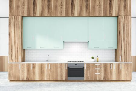 Interior of stylish kitchen with white brick walls, concrete floor, wooden countertops with built in stove and sink and light blue cupboards. 3d rendering