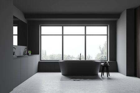 Interior of stylish bathroom with grey walls, concrete floor, window with gray bathtub under it and comfortable double sink with large mirror. 3d rendering
